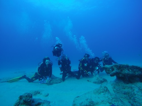Andrew Johnson, Alfredo Barroso, Brad Erisman, David Ivan Castro and Timothy Rowell pose for a photo following a long reef dive
