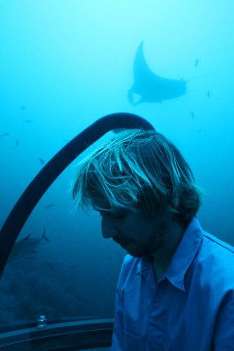Dr Andrew F Johnson explores the waters around San Benedicto of the Revillagigedo islands in the Argo's UnderseaHunter Submarine (followed by a giant manta (Manta birostris)).